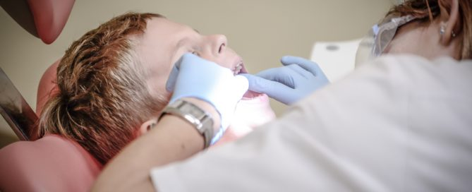 Dentist looking at patient
