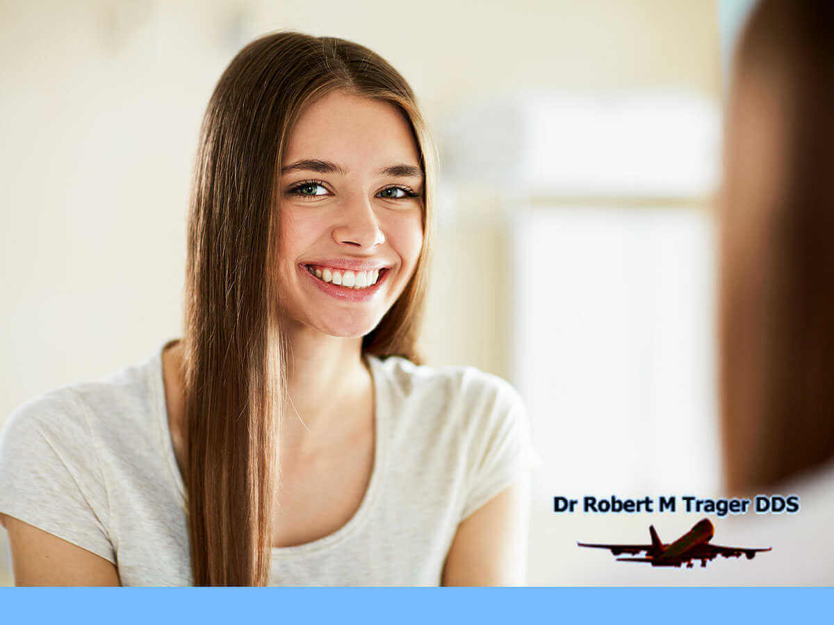 Girl With a Beautiful White Smile After a Professional Teeth Whitening Treatment In Queens, NY